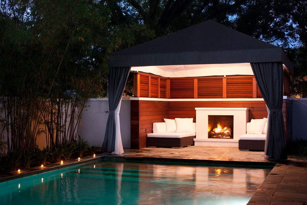 Modern Cabana for a Transitional Pool with a Wood Fence and Culbreath Isle Garden by David Conner + Associates