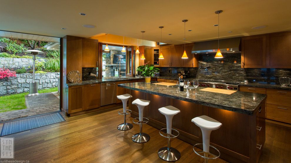Modern Mobler for a Contemporary Kitchen with a Breakfast Bar and Pushing the Envelope by Synthesis Design Inc.