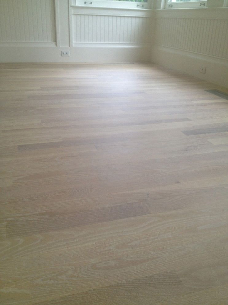 Monocoat for a Contemporary Spaces with a White Floor and Rubio Monocoat Cotton White by Eco Options Hardwood