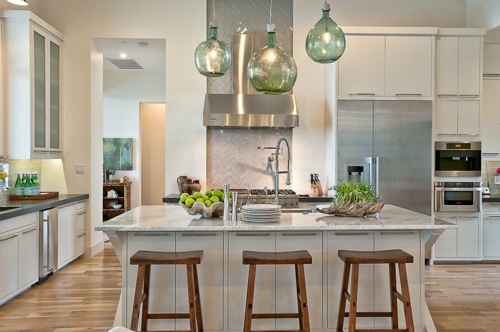 Mont Granite for a Transitional Kitchen with a Stainless Steel Appliances and Cat Mountain Residence by Cornerstone Architects