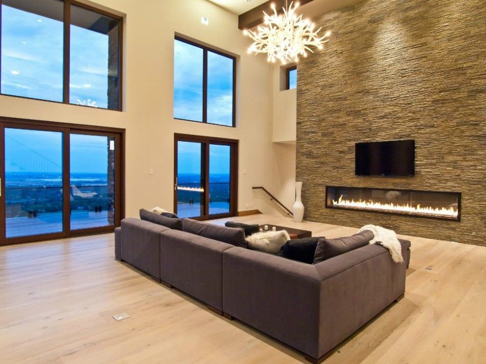 Montigo for a Contemporary Living Room with a Television and 10' Custom Gas Fireplace by Montigo Fireplaces