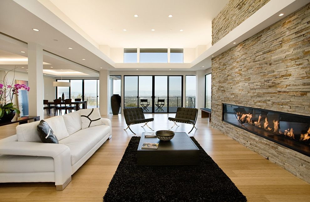 Montigo for a Modern Living Room with a Big Window and 10' Custom Gas Fireplace by Montigo Fireplaces