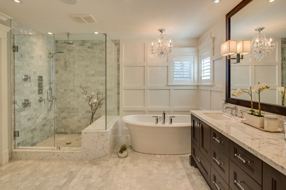 Moore Plumbing Supply for a Traditional Bathroom with a Crystal Chandelier and New West Classic by Clay Construction Inc.