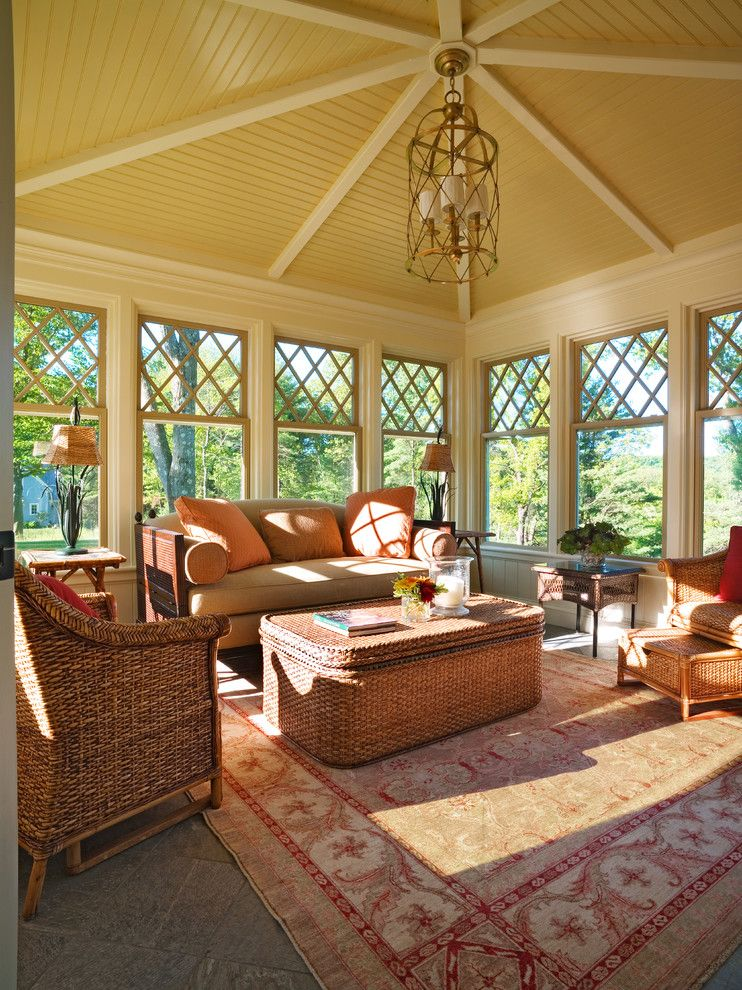 Mor Furniture for a Victorian Sunroom with a Caged Chandelier and Sitting Room by Hart Associates Architects, Inc.