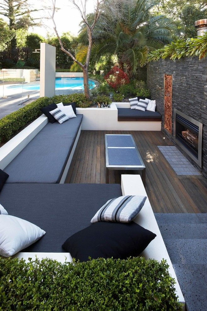 Mor Furniture for Less for a Contemporary Patio with a Fireplace and Sunken Connections by Dean Herald Rolling Stone Landscapes
