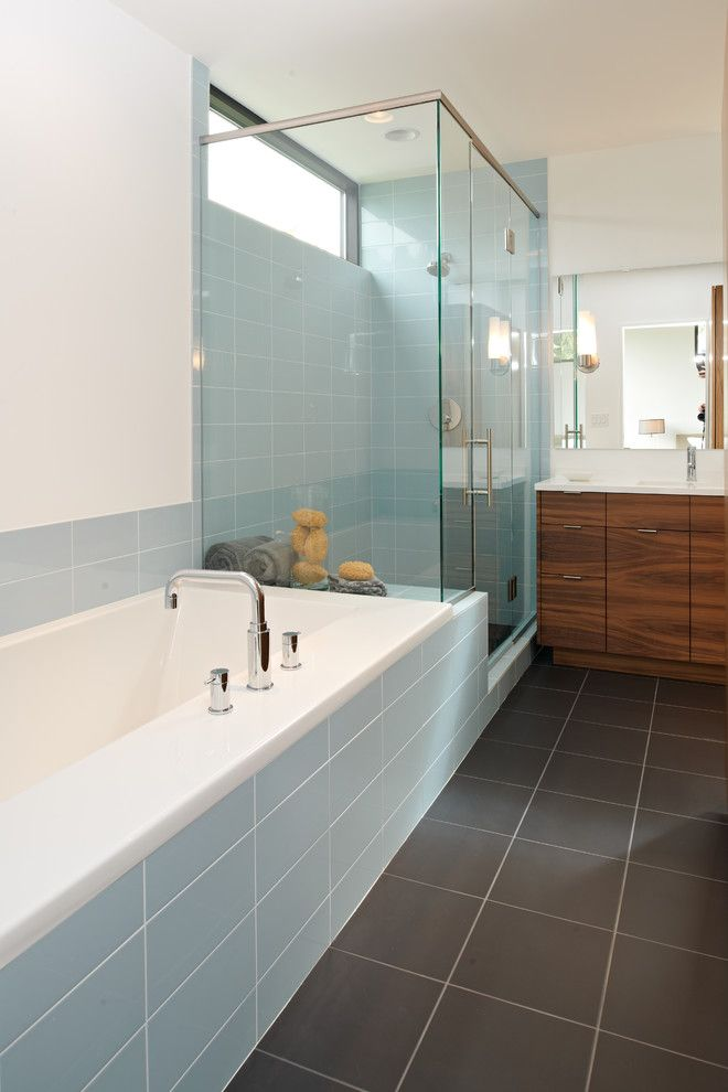 Mosa Tile for a Modern Bathroom with a Clerestory and Bathroom by Citydeskstudio, Inc.