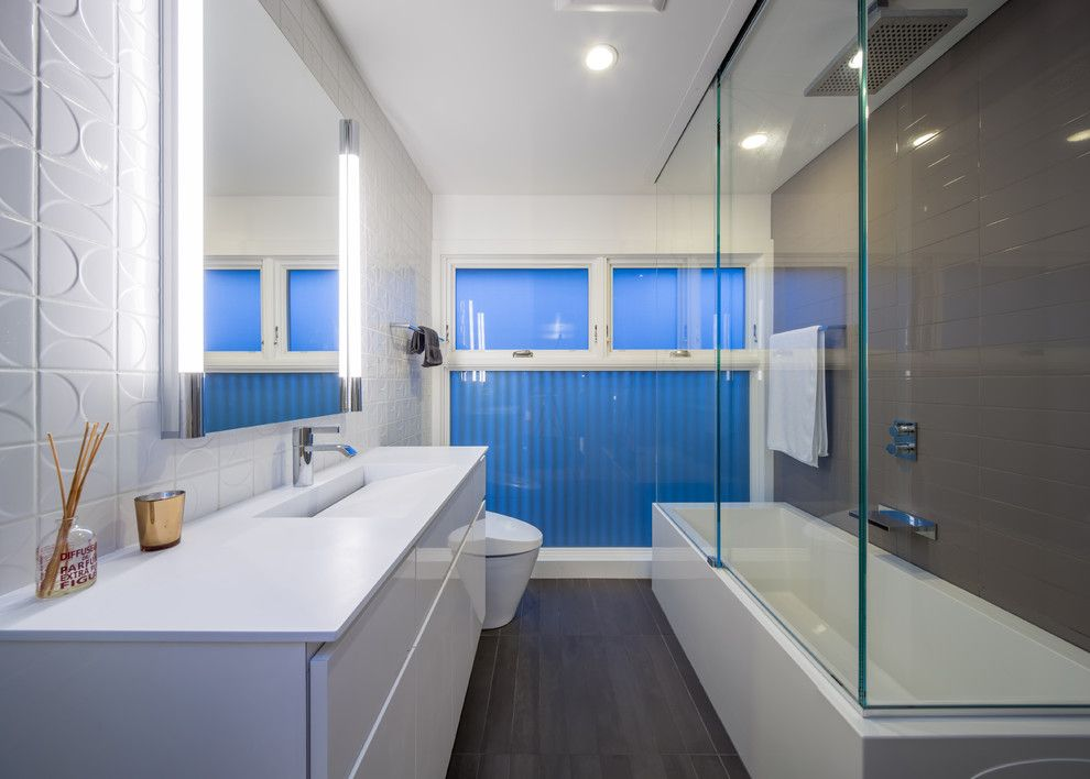 Mosa Tile for a Modern Bathroom with a Frosted Glass and Minneapoli Riverfront Mid Century Modern Remodel by Citydeskstudio, Inc.