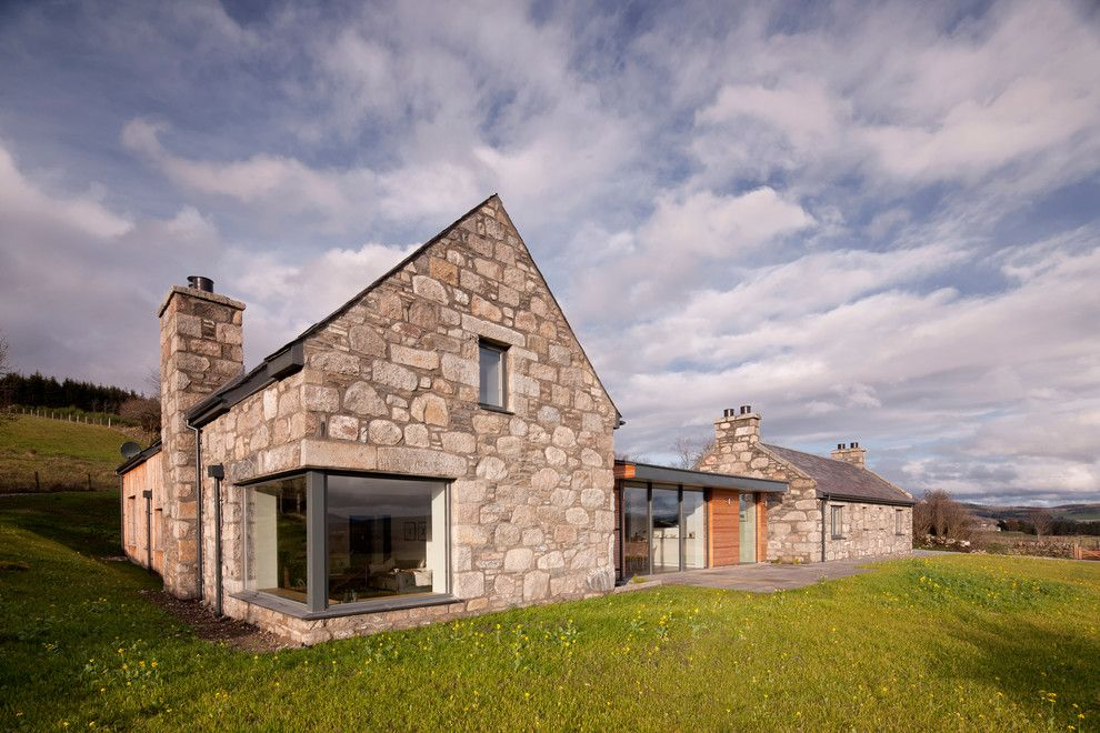 Moscow Building Supply for a Farmhouse Exterior with a Stone Exterior and Torispardon Cottage by Drbarbour Photography