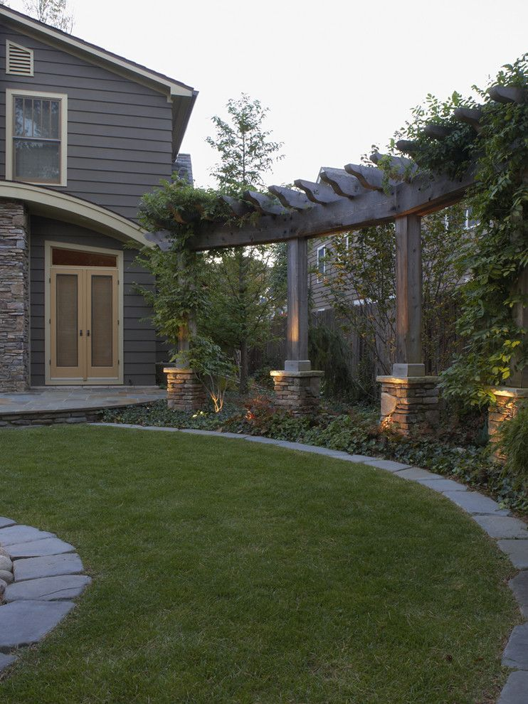 Mossy Oak Fence for a Contemporary Landscape with a Rock Base and Pergolas and Arbors by Great Oaks Landscape Associates Inc.