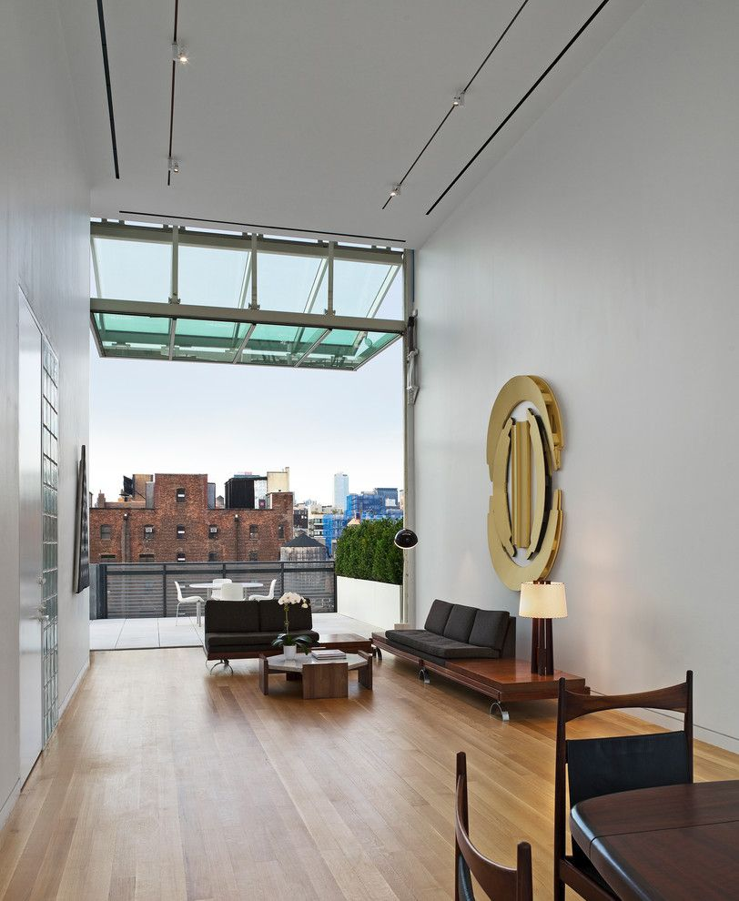 Muji Us for a Contemporary Living Room with a Glass Awning and 2014 Pritzker Architecture Prize: Shigeru Ban by Pritzker Architecture Prize