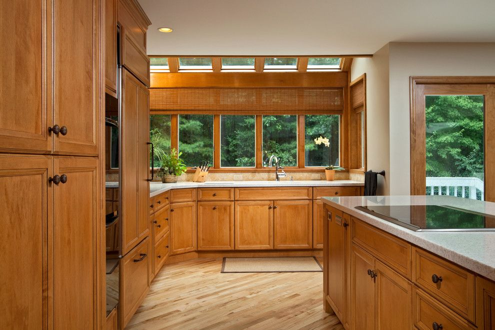 Mullioned Windows for a Traditional Kitchen with a Integrated Refrigerator and Modern Luxury by Teakwood Builders, Inc.