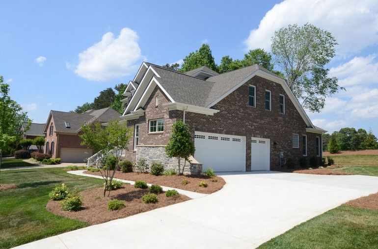 Multigenerational Homes for a Contemporary Exterior with a Custom Home and River Run at Davidson, Nc by Evans Coghill Homes