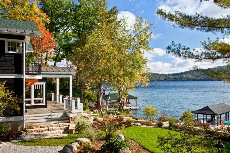 Multigenerational Homes for a Traditional Exterior with a Lake House and Legend of the Lake by Teakwood Builders, Inc.