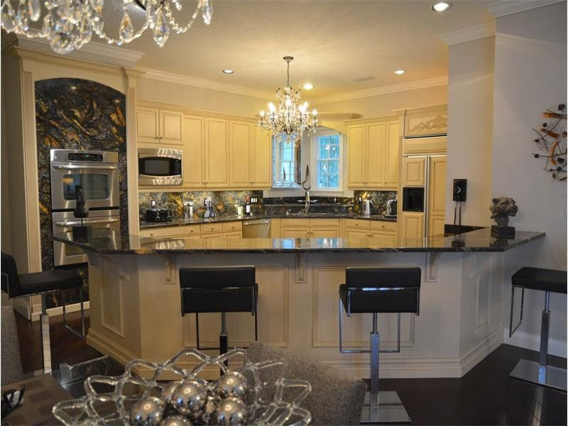 Mystic Granite for a Contemporary Kitchen with a Golden Saturnia and Exotic Stone Installs by Mystic Granite & Marble