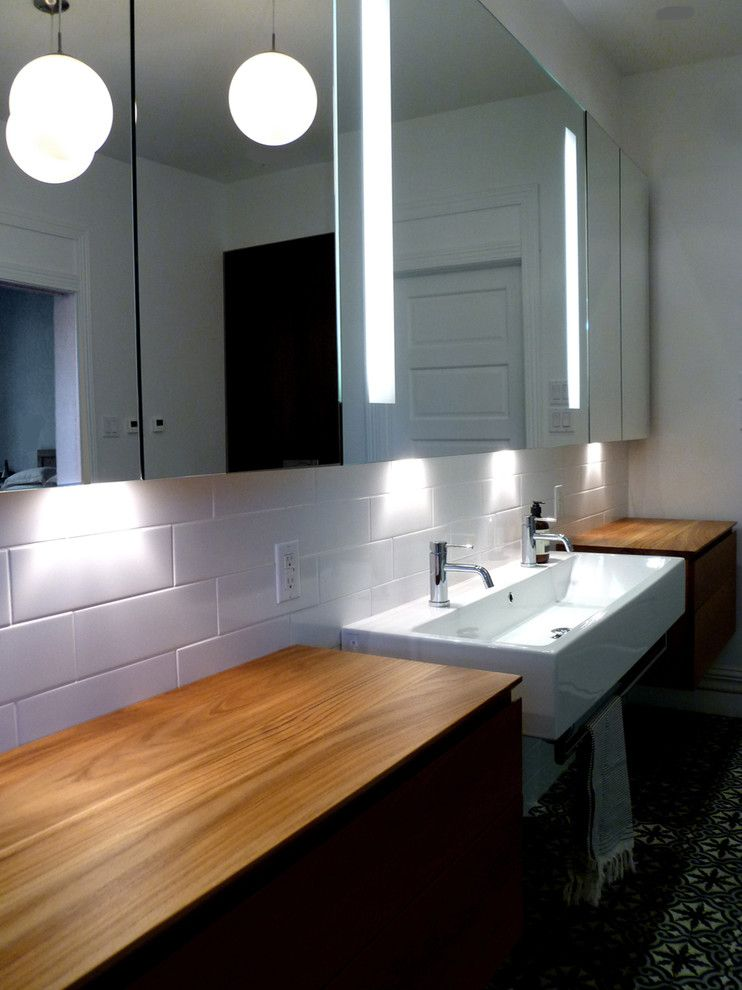 Nadeau Furniture for a Contemporary Bathroom with a Moldings and Résidence Côte Ste Catherine by Johanne Nadeau Studio