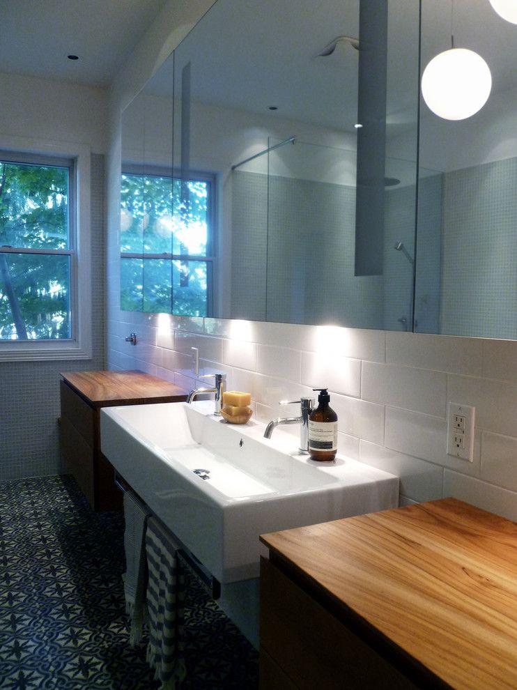 Nadeau Furniture for a Contemporary Bathroom with a Rain Shower and Résidence Côte Ste Catherine by Johanne Nadeau Studio