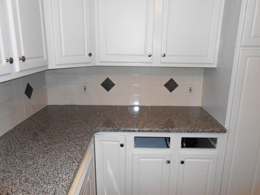 New Caledonia Granite for a Traditional Kitchen with a Caledonia and Caledonia Granite for White Cabinets by Fireplace & Granite Distributors