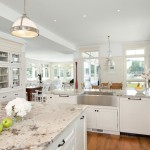 New Caledonia Granite for a Traditional Kitchen with a Farmhouse Sink and Waterfront Estate by Jodi Foster Design + Planning