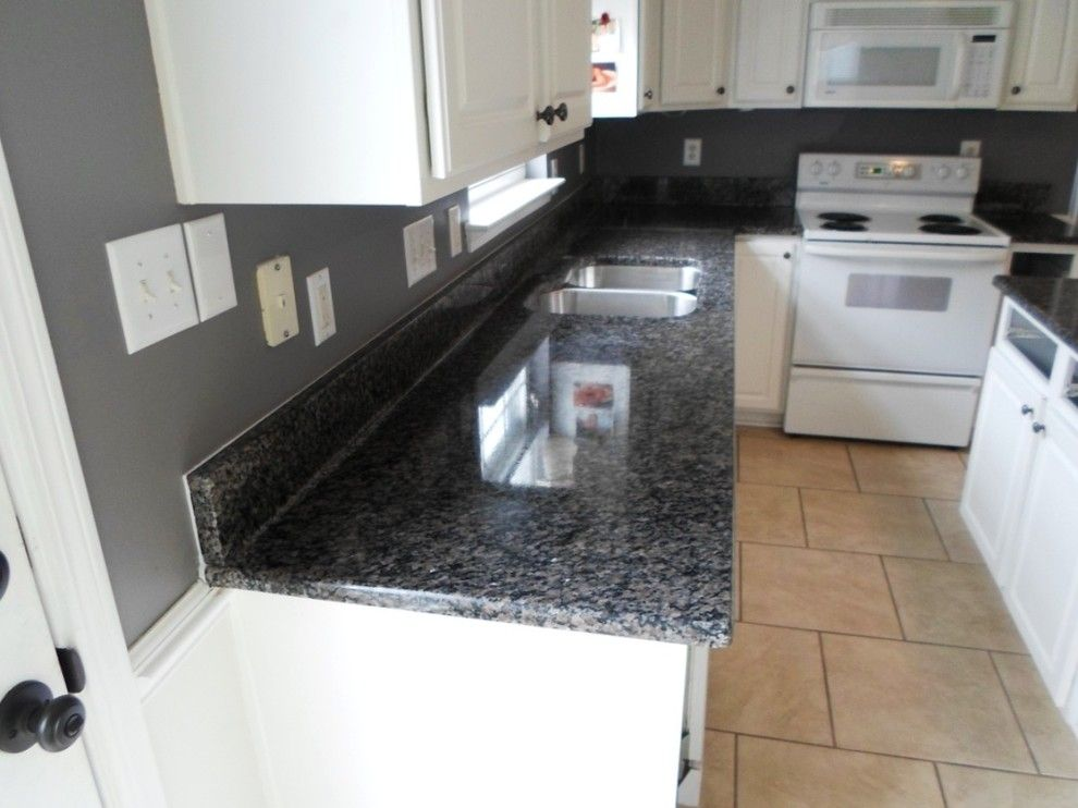 New Caledonia Granite for a Traditional Kitchen with a Granite Edge and Caledonia Granite for White Cabinets by Fireplace & Granite Distributors