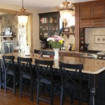 New Venetian Gold Granite for a Traditional Kitchen with a Black Cabinets and Granite by Stone Masters Inc