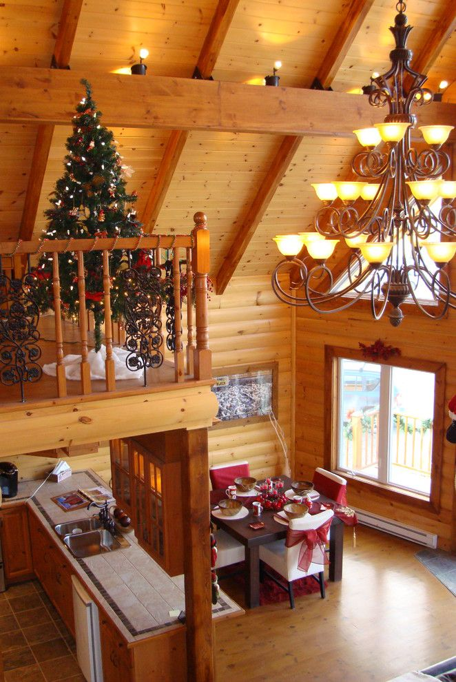 Niblock Homes for a Rustic Family Room with a Merry Christmas and Timber Block Log Home Photos by Timber Block Homes