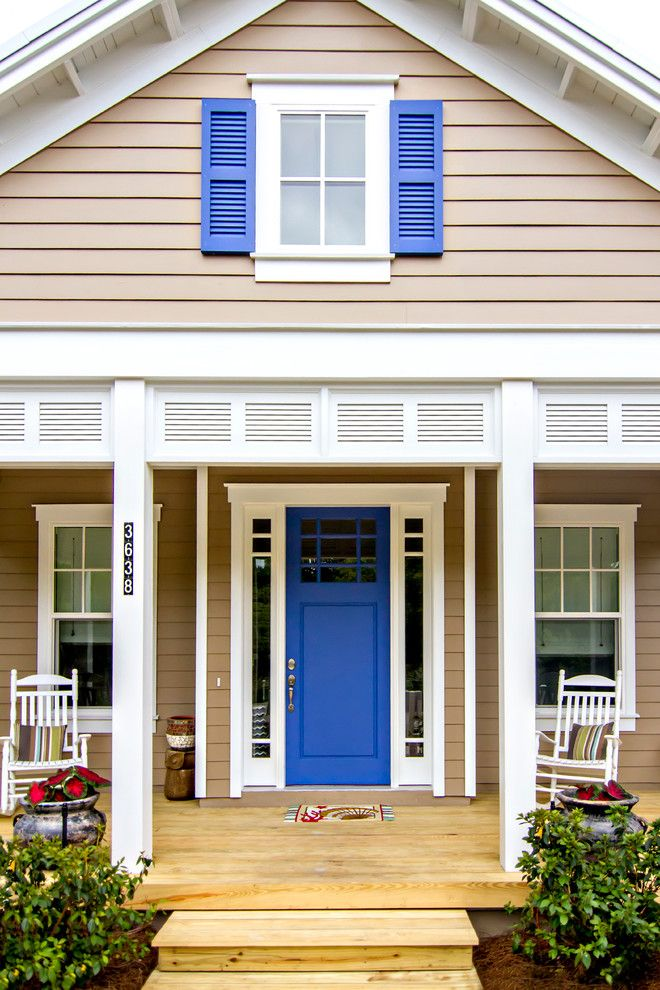 Nichiha for a Beach Style Porch with a Covered Porch and Front Doors by Glenn Layton Homes
