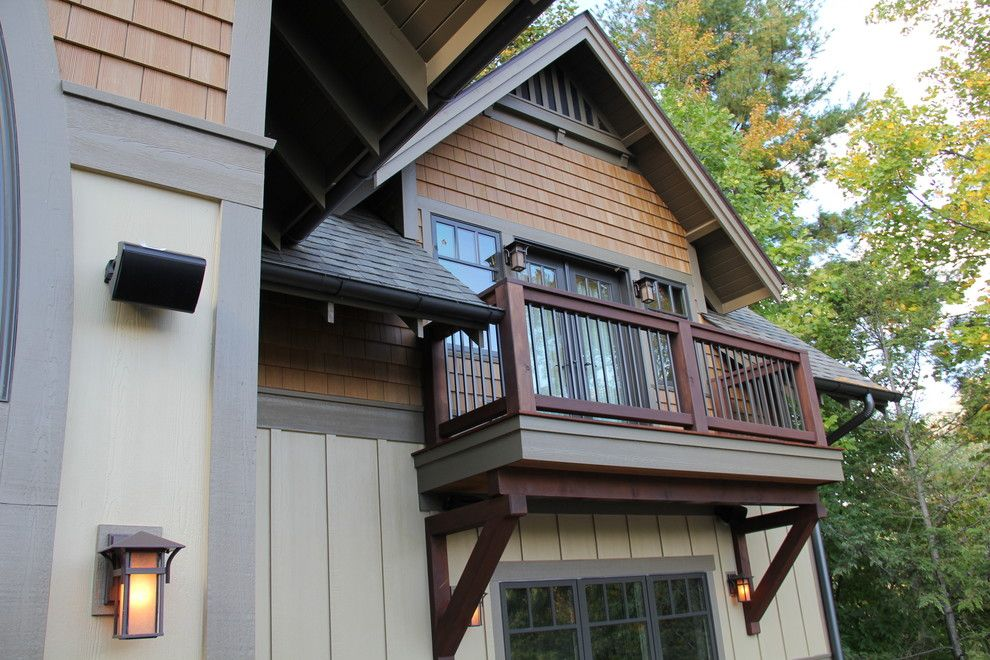 Nichiha Siding for a Craftsman Exterior with a Lake Home and Bertsch Furimsky by Living Stone Construction, Inc.
