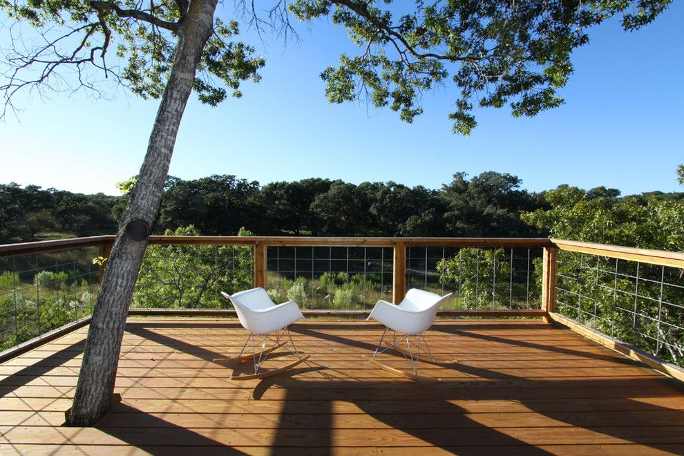 Nichols Lumber for a Modern Deck with a Tree in Deck and Pivot Pad, Ignacio Salas Humara Architect by Ignacio Salas Humara Architect Llc