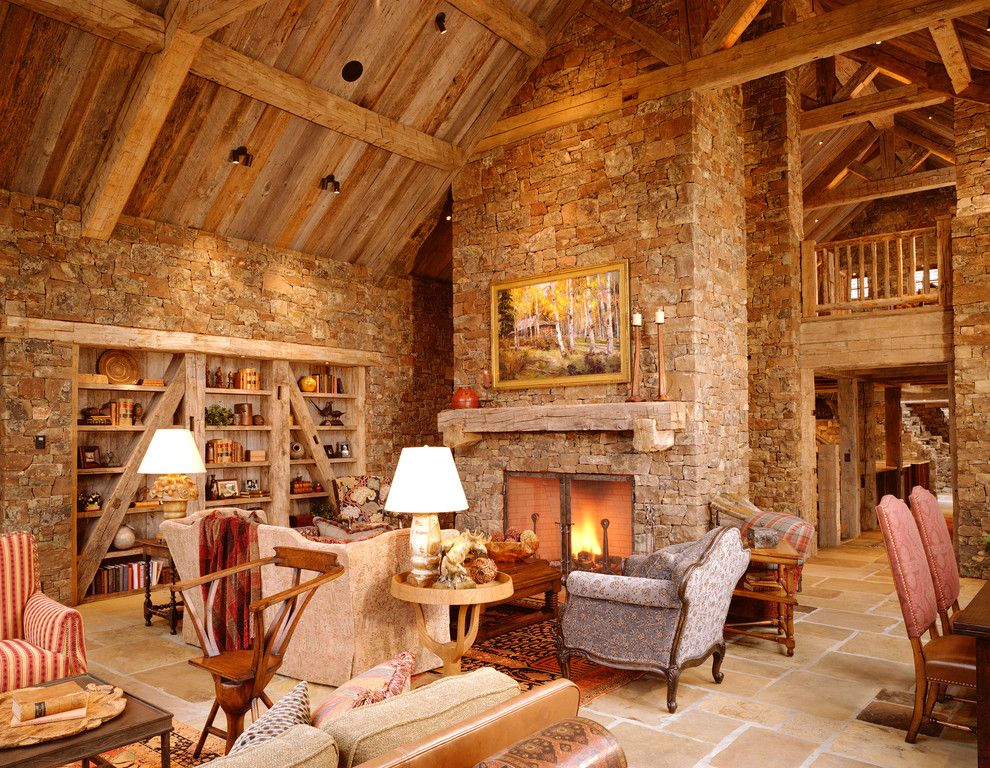 Nichols Lumber for a Rustic Family Room with a Cathedral Ceiling and Snake River Residence by Jlf & Associates, Inc.