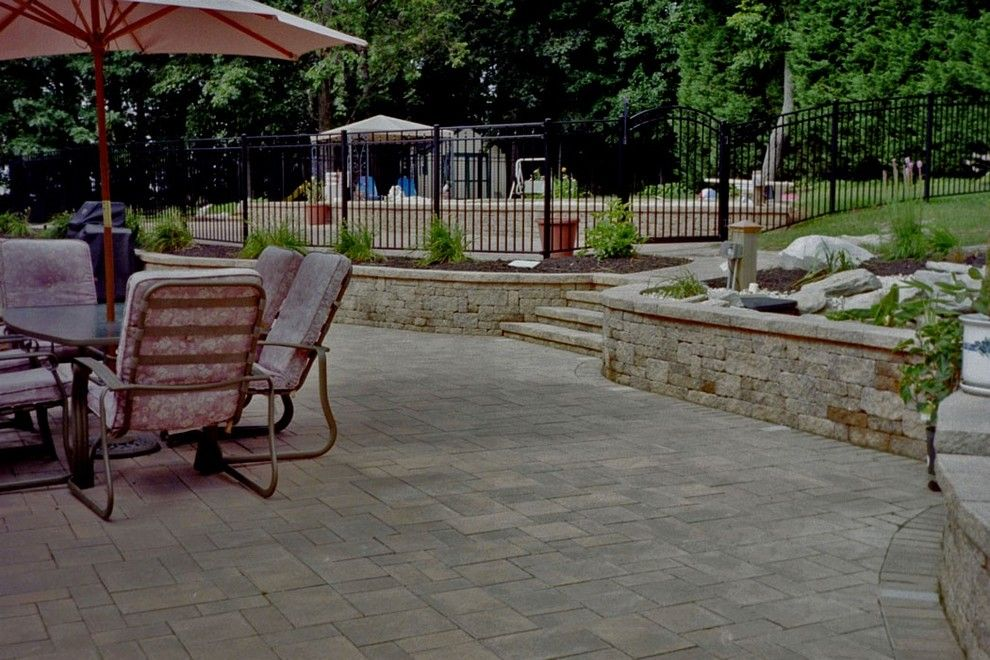 Nicolock Pavers for a  Spaces with a Icpi and Paver Patios by Kingdom Landscaping