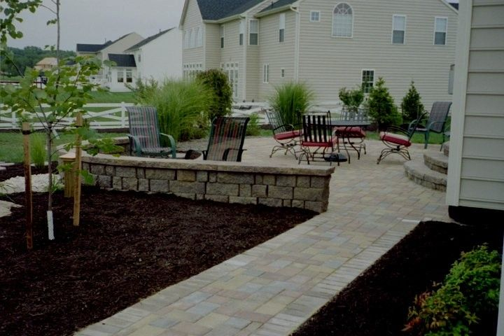 Nicolock Pavers for a  Spaces with a Paver Driveways and Paver Patios by Kingdom Landscaping