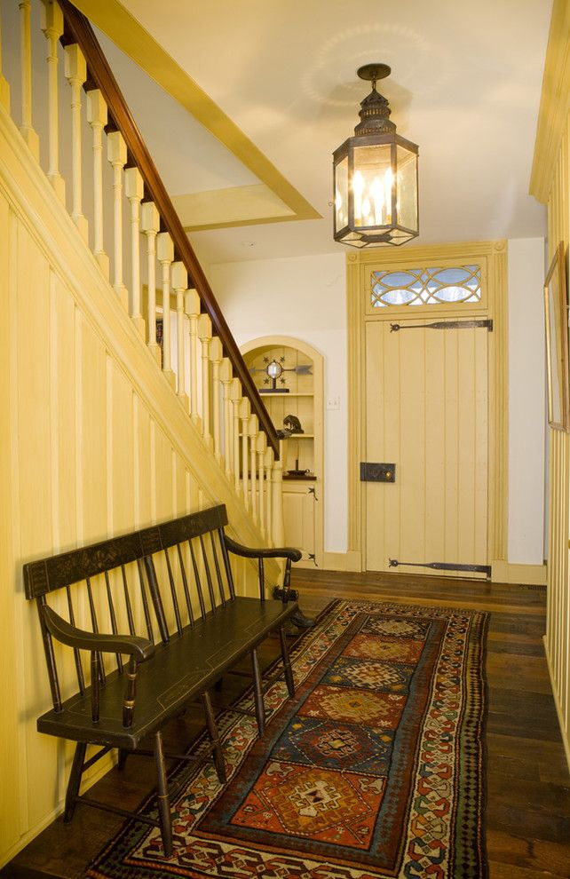 Nw Artisan Hardware for a Farmhouse Entry with a Transom and Starry Night Farm - Stair Hall by Archer & Buchanan Architecture, Ltd.
