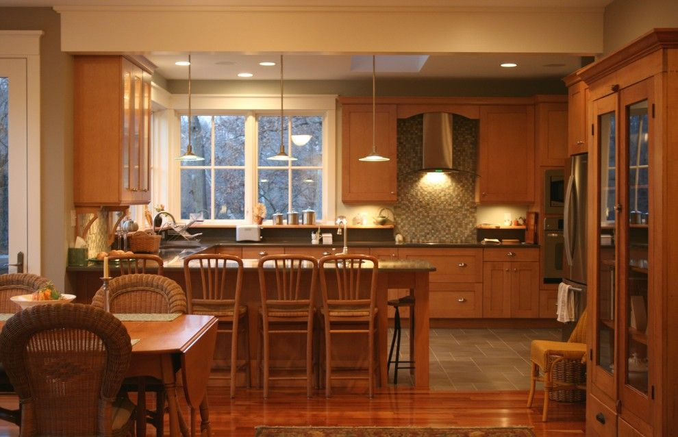 Oceanside Glass Tile for a Traditional Kitchen with a Ceiling Lighting and Custom Kitchen by Studio on Cedar Llc
