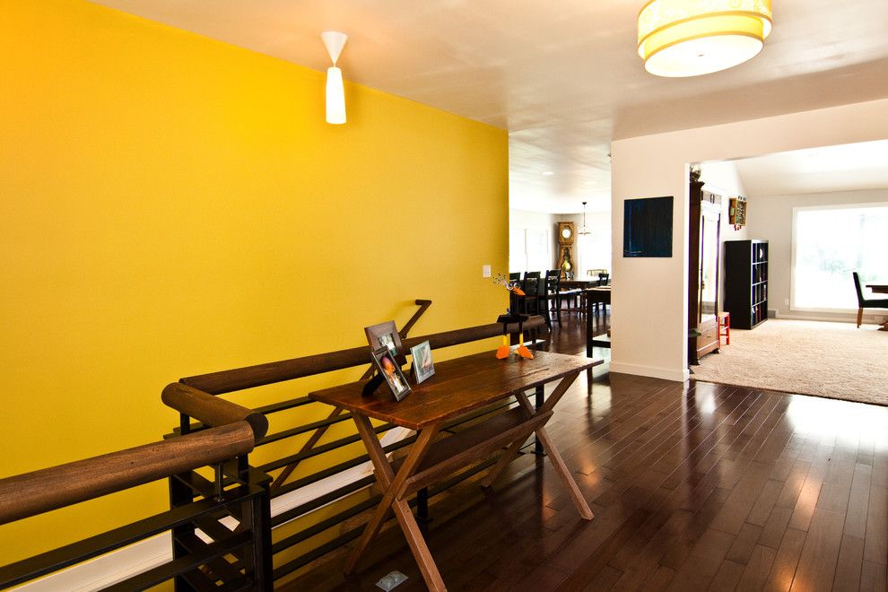 Ochre Color for a Modern Hall with a Color and Living by Noah Herman Sons Builders
