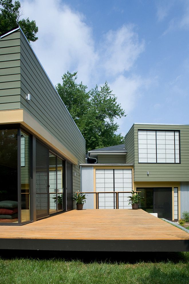 Ochre Color for a Transitional Exterior with a Kalwall and Fifties Split by Gardner Mohr Architects Llc