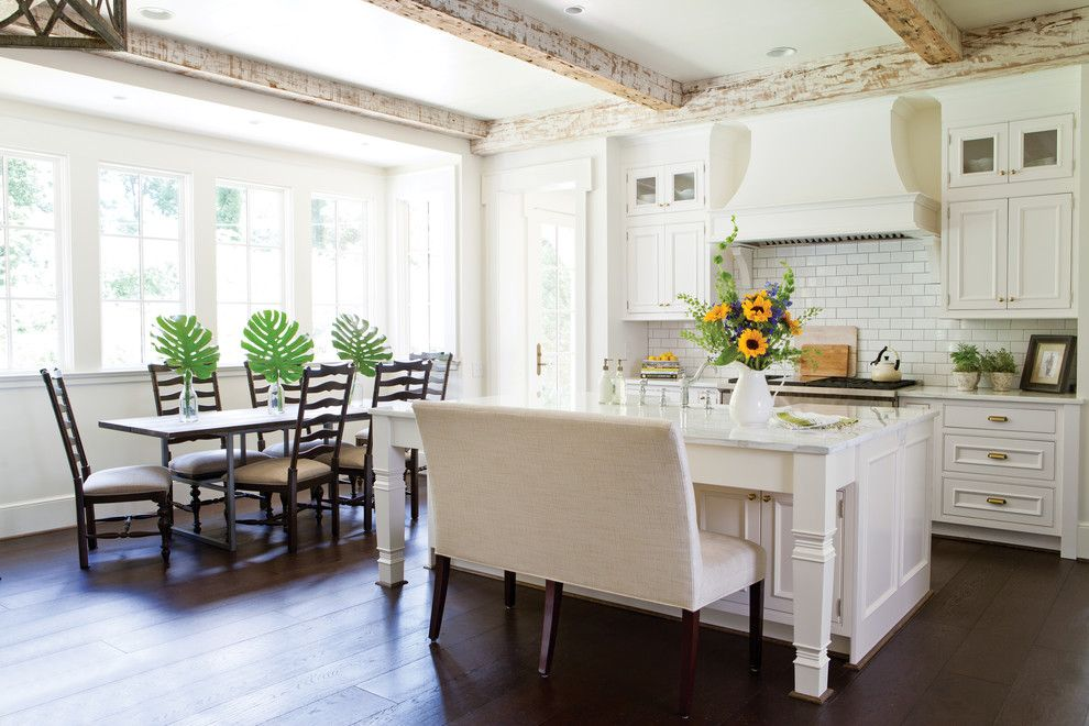 Ochre Lighting for a Traditional Kitchen with a Dining Bench and Wellborn Cabinet by Wellborn Cabinet, Inc.