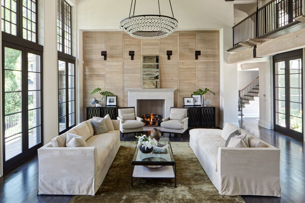 Ochre Lighting for a Traditional Living Room with a Armchairs and Lake Geneva Basswood by Michael Abraham Architecture