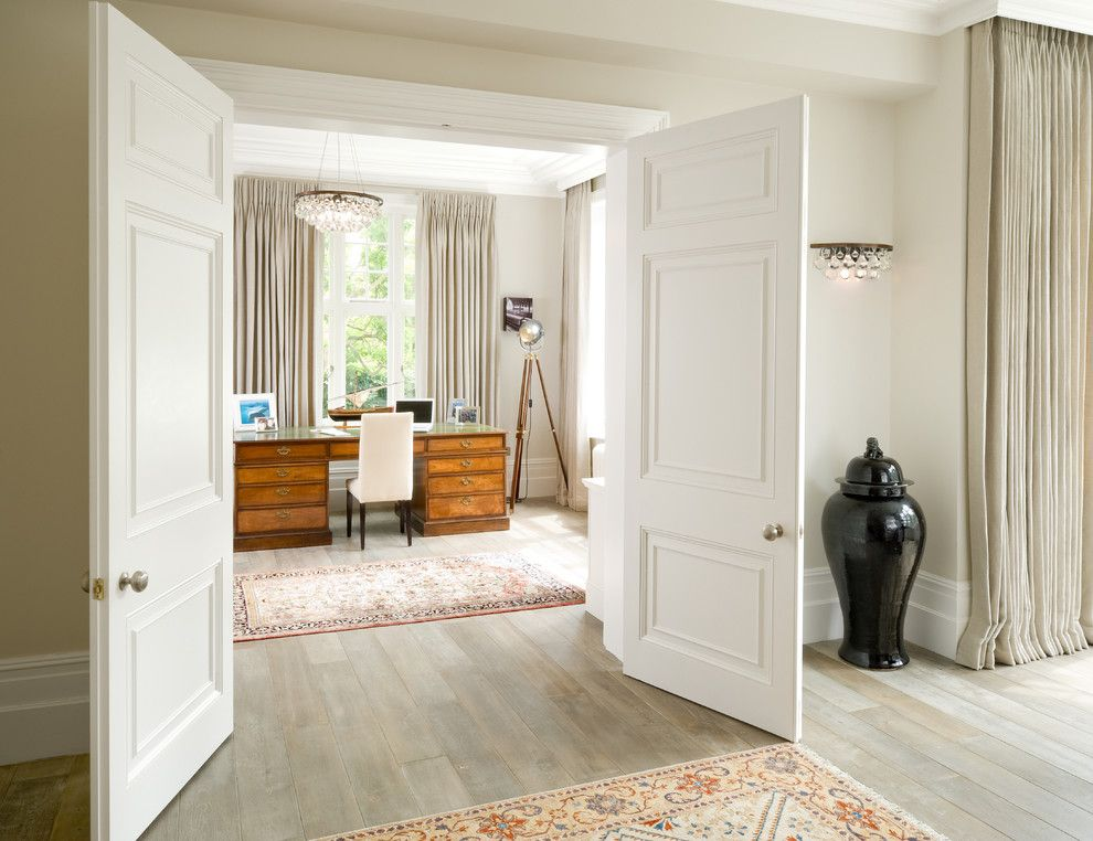 Ochre Lighting for a Victorian Home Office with a Tripod Floor Lamp and Stunning Hallway Looking Into Beautifully Finished Home Study by London Basement