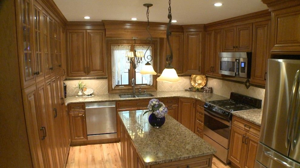 Omega Cabinetry for a Mediterranean Kitchen with a Light Wood Flooring and Jay M by Curtis Lumber Ballston Spa