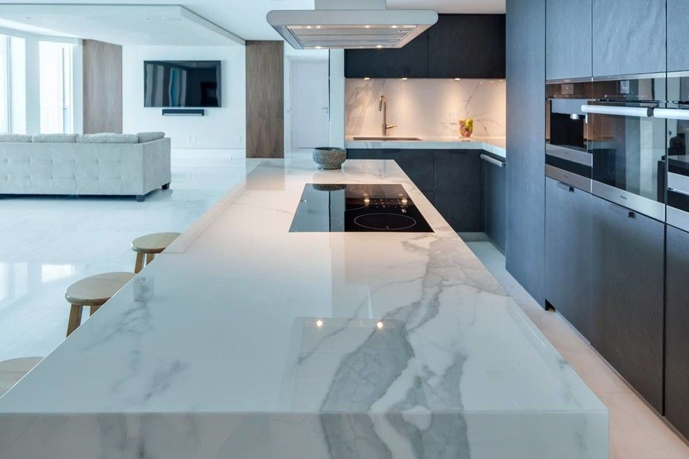 Omicron Granite for a Modern Spaces with a Pool and Luxury Miami Beach Project   Featuring Neolith and 2id Interiors by Omicron Granite & Tile