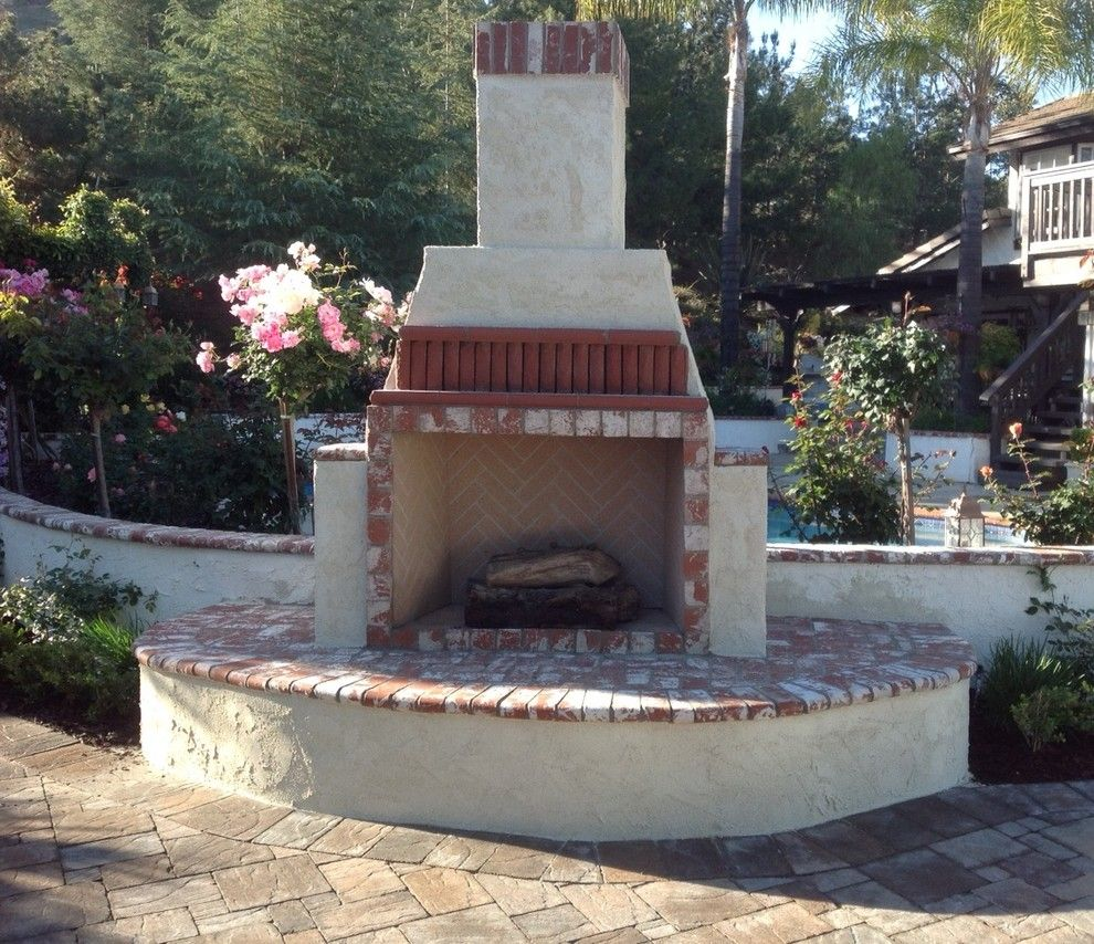 Orco Block for a Craftsman Patio with a Fireplace and Orco Fireplaces by Orco Block & Hardscape