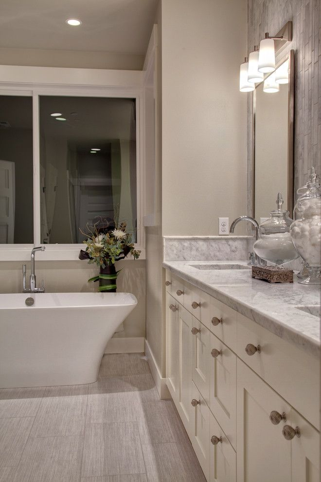 Oregon Tile and Marble for a Transitional Spaces with a Shaker Vanity Cabinet and Woodinville Retreat by Interiors