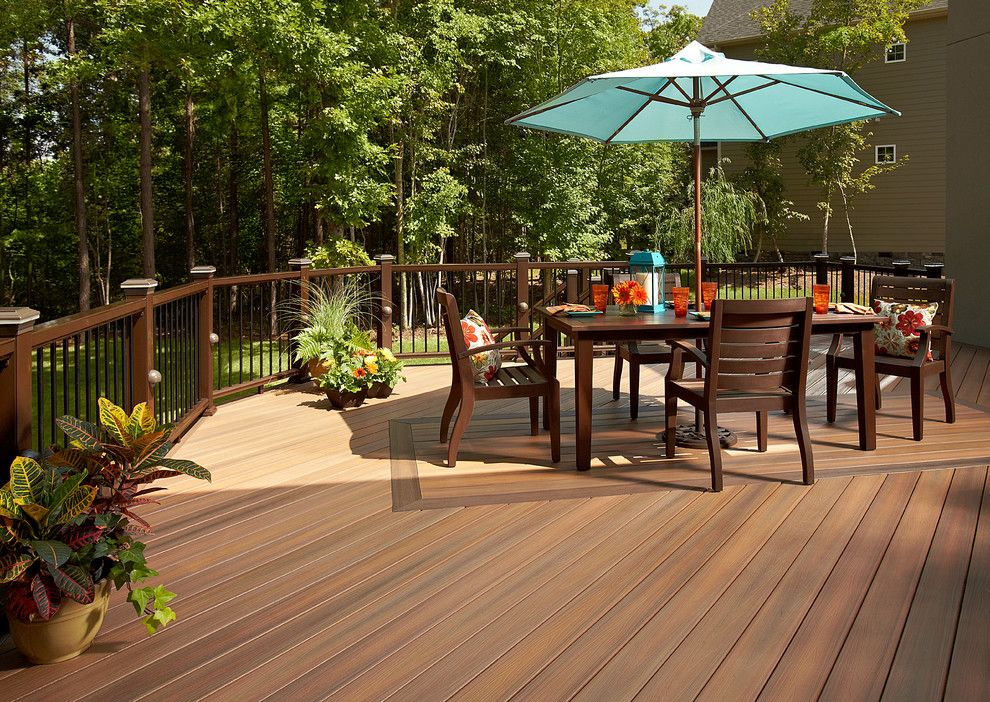 Orient Express Furniture for a  Deck with a Wood Railing and Fiberon by Fiberon Decking