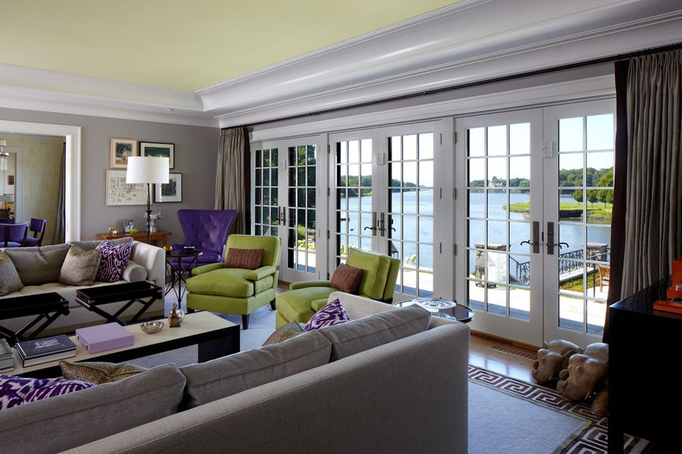 Ortal Fireplaces for a Transitional Living Room with a Grey Sofa and Greenwich Residence by Leap Architecture