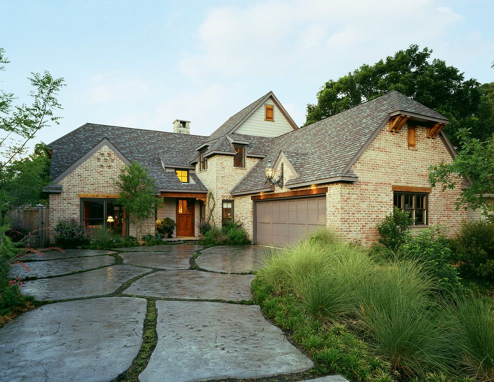Owens Corning Cultured Stone for a Farmhouse Exterior with a Gray Fascia and Farmhouse by Michael Lyons Architect