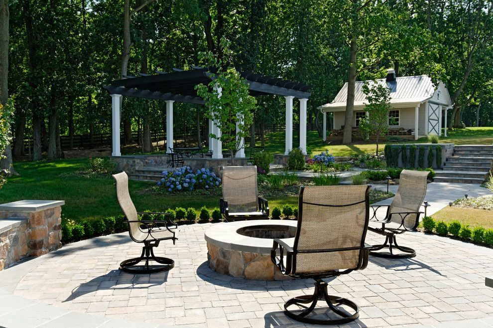 Owens Corning Cultured Stone for a Traditional Patio with a Seat Wall and Multi Room Rear Landscape by Inviting Spaces