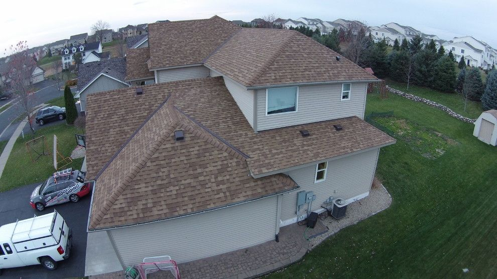Owens Corning Duration for a Modern Exterior with a Roofing Contractor and
