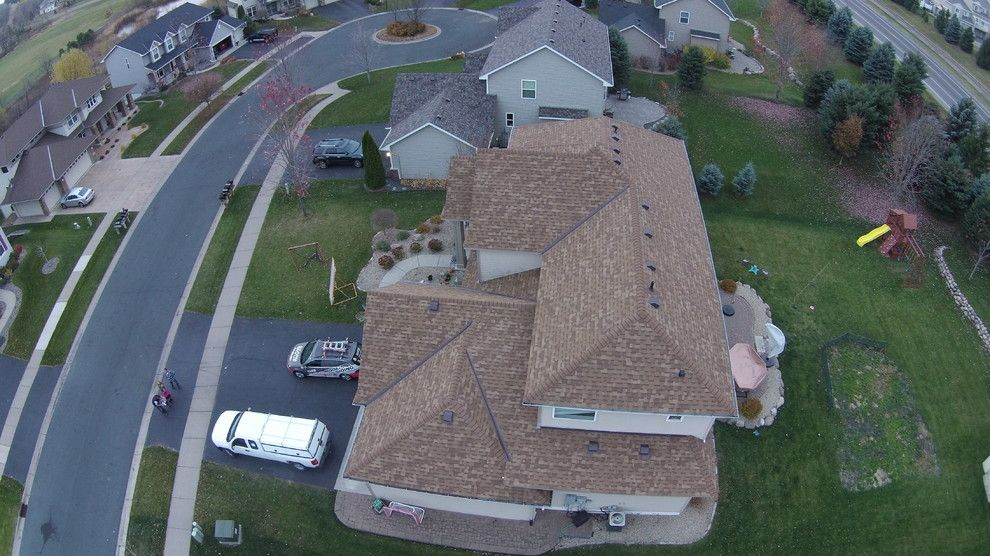 "Owens Corning Duration for a Modern Exterior with a Roofing Contractor and ""Desert Tan"" Owens Corning Duration Roof by Storm Group Roofing. by Storm Group Roofing, LLC"