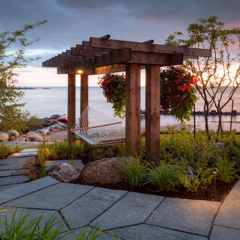 Padio for a Beach Style Patio with a Water View and the Landmark Group by Mcneill Photography