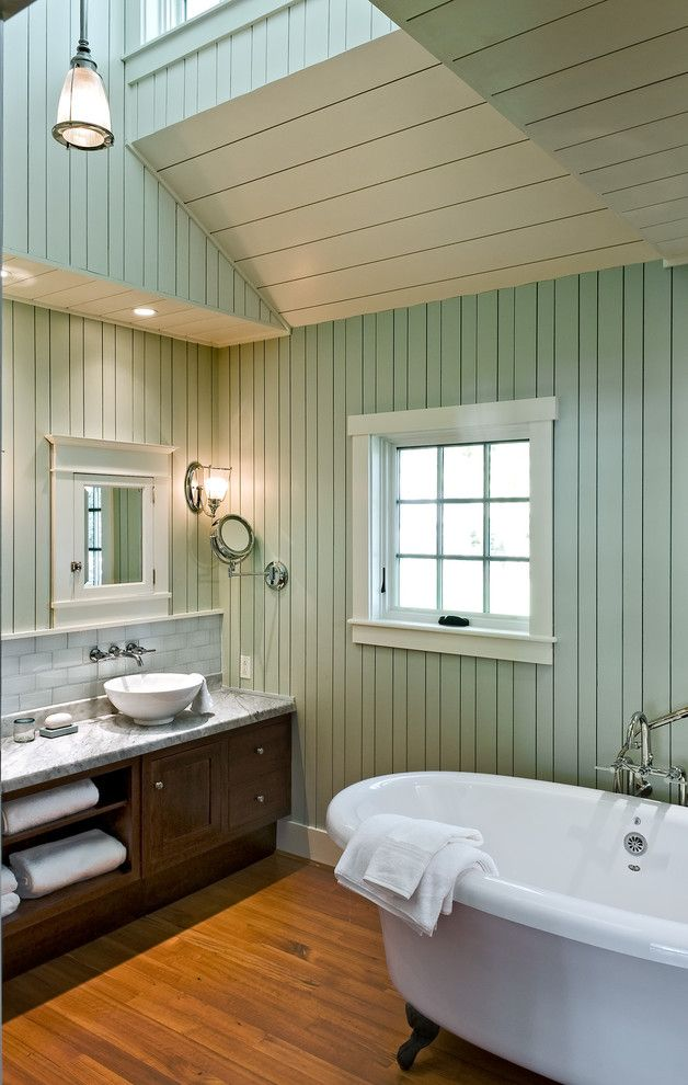 Painted Paneling for a Beach Style Bathroom with a Wood Ceiling and Bathroom by Whitten Architects